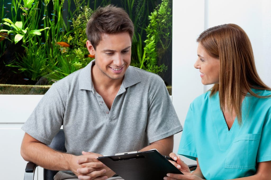 the smile doctor discussing dental payment options with patient