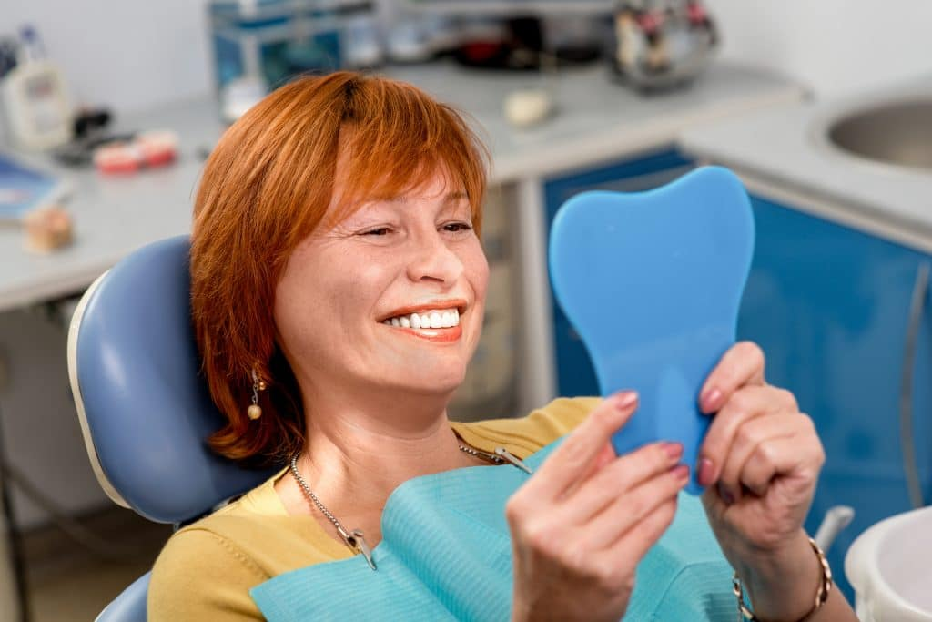 the smile doctor smiling patient with dentures